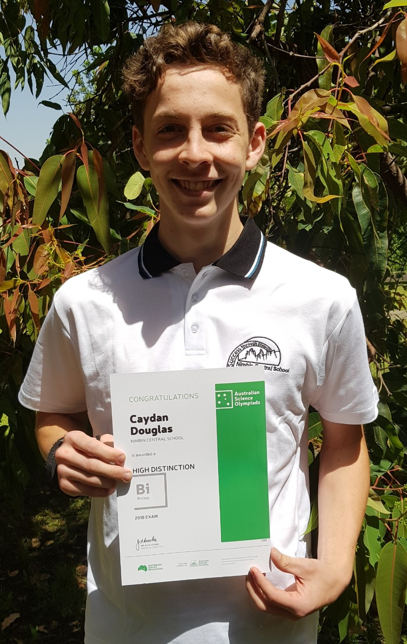Caydan Douglas holding his high distinction certificate
